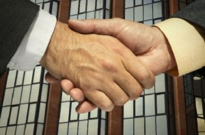 two-businessmen-shaking-hands_l
